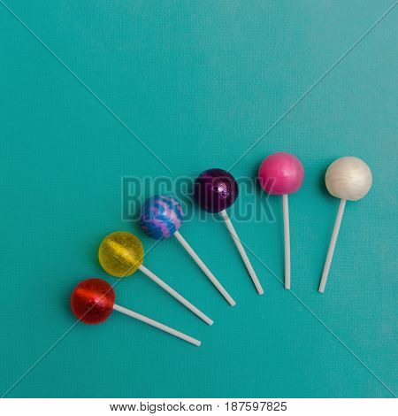 Lollipop Flat lay Minimal concept Six colorful round lollipops are lying on a light blue background One-color and two-color candies