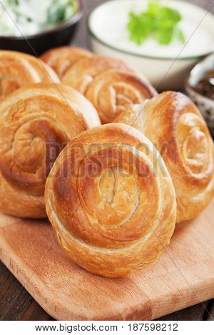 Phyllo pastry cheese pies with yogurt and salad