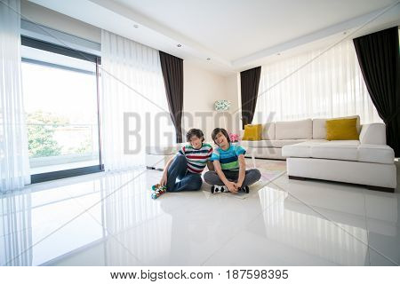 Happy brothers at living room in hotel apartment