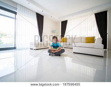 Happy boy at living room apartment