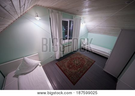 Interior of room with two beds in hotel.