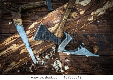 Old carpentry tools on the wooden board