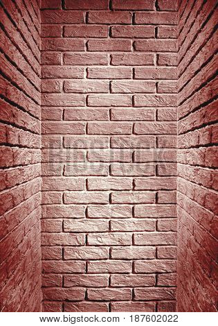 red toned brick wall end of the corridor, abstract background photo