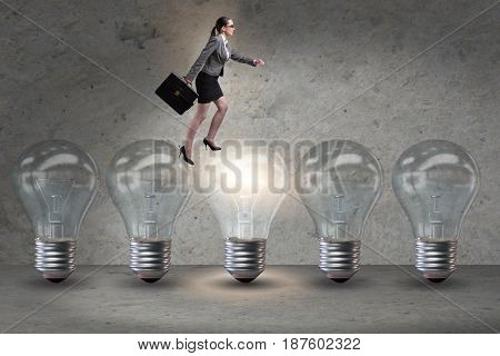Businesswoman in new idea concept with light bulb