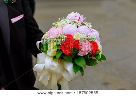 The Groom Holds A Bouquet Of Flowers Male Hands