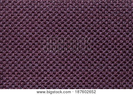 Dark purple background with checkered pattern closeup. Structure of the wine fabric macro.