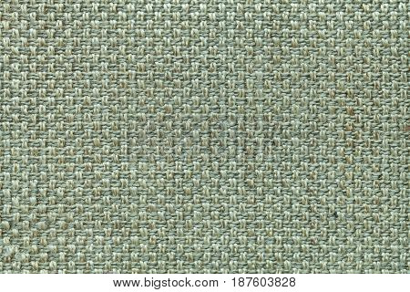 Light olive background with checkered pattern closeup. Structure of the green fabric macro.