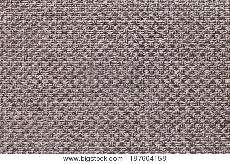 Light brown background with checkered pattern closeup. Structure of the gray fabric macro.