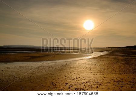 Camber Sands beach at low tide in spring  at sunset, East Sussex, England, U.K