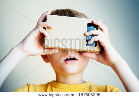 Child with virtual reality headset. Close up portrait