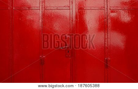 Red metal sheet door with handle security concept
