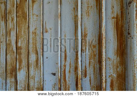 Rusty and weathered metal sheet wall for background and texture