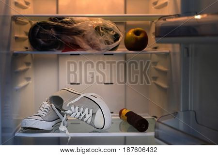 Comic ptcture with a sneakers in a refrigerator