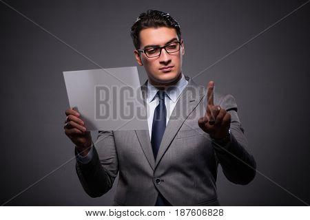 Handsome businessman working on tablet computer