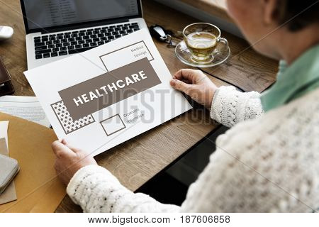 Woman working on digital device network graphic overlay