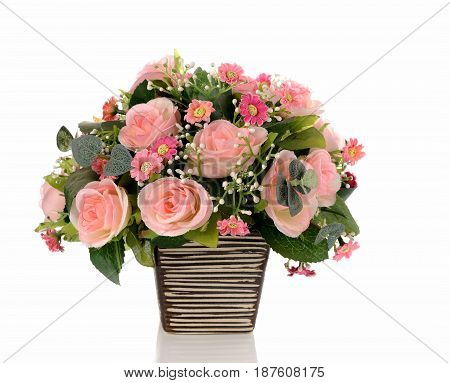 Bouquet of pink roses in a vase on white background