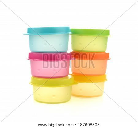 Plastic containers for food with lid ajar isolated on white colorful
