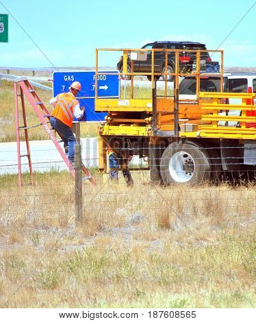 JULY 15, 2012.  CASPER, WY.  Highway crew working and repairing sign on the interstate in Casper, Wy.