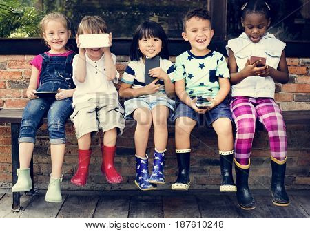 Group of Diverse Kids Using Mobile Phone Device Together