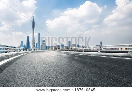 empty road with landmark buildings in guangzhou