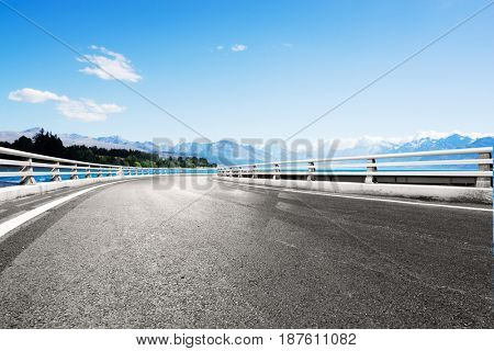 landscape of blue lake in blue sky from empty road