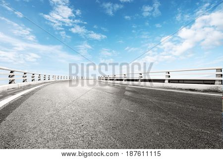 empty road in blue sunny sky