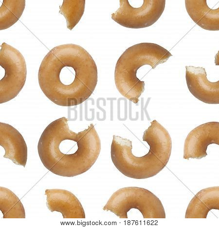 Seamless pattern of bites taken off a donut isolated on white background