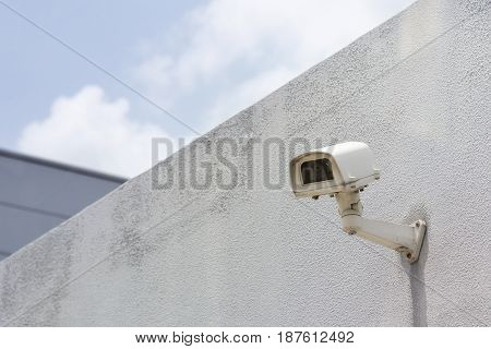 The CCTV camera attach at the concrete wall. Security lift concept