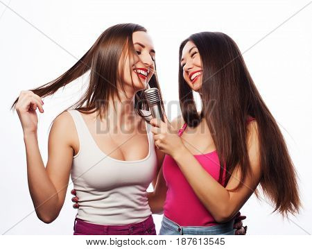 young girls friends with microphone