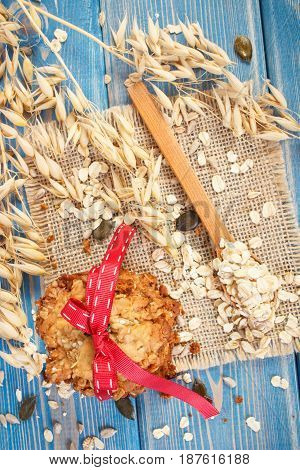 Fresh Baked Oatmeal Cookies With Ingredients And Ears Of Oat, Healthy Dessert Concept