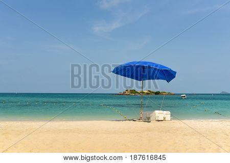 umbrella on beach sand and sea background