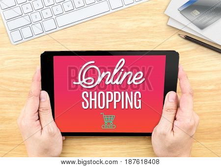 Hand Holding Tablet With Online Shopping Word On Wood Table ,internet Marketing Concept.