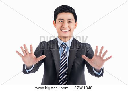 Asian Man In Black Suit Pushing Blank Virtual Button On Touch Screen.
