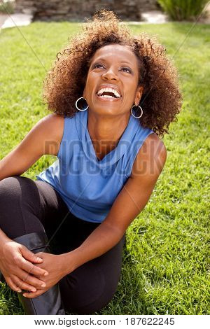 Mature Beautiful African American woman smiling outside.