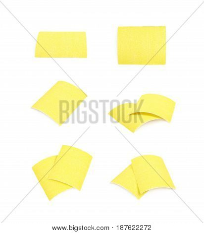 Piece of a sandpaper emery paper sheet, composition isolated over the white background, set of six different foreshortenings