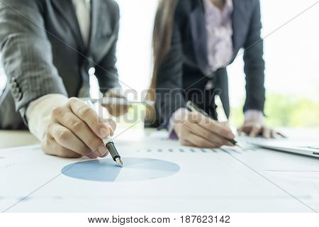 Business people analyzing investment charts in meeting room Accounting concept soft focus vintage tone