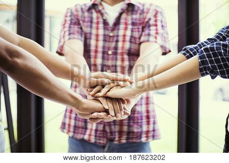 people showing unity with their hands together teamwork and together concept soft focus vintage tone