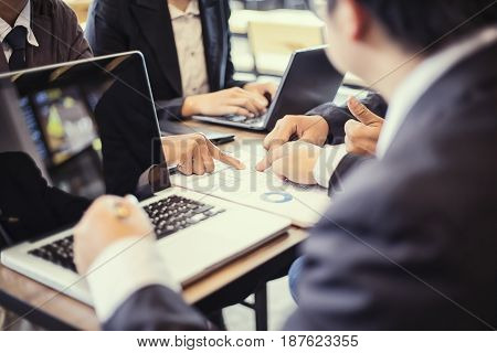 Business business partners discussing documents and ideas at meeting Business concept soft focus vintage tone