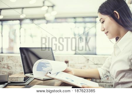 Business businesswoman using laptop working in office Business concept soft focus