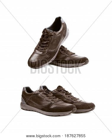 Pair of casual semi-sport black leather shoes, composition isolated over the white background, set of two different foreshortenings