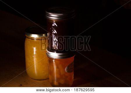 Jars of homemade jams on a table