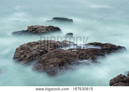 Long Exposure Of Waves and Rocks in the Pacific Ocean. Montara, San Mateo County, California, USA