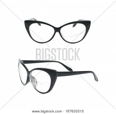 Pair of black plastic sight glasses with the broken lens glass, composition isolated over the white background, set of two different foreshortenings