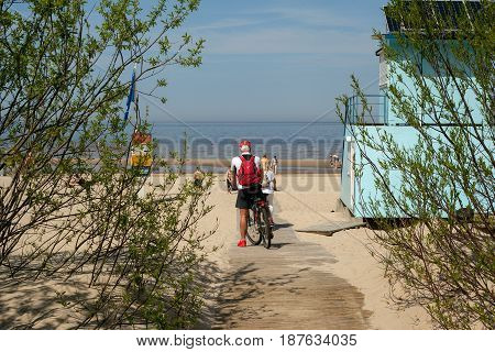 Jurmala, Latvia - May 20, 2017: People at the Baltic sea in Jurmala, Latvia recreational resort