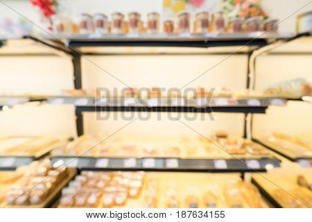 Blurred bakery shop background. cake donut pie bread