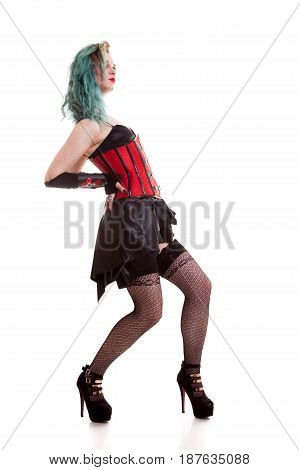Gorgeous BDSM model in leather corset isolated on white background in studio photo