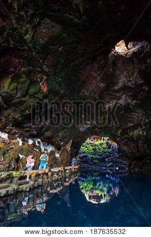 Lanzarote, Spain - March 29, 2017: People Visiting Volcanic Cave In Jameos Del Agua, Lanzarote, Cana