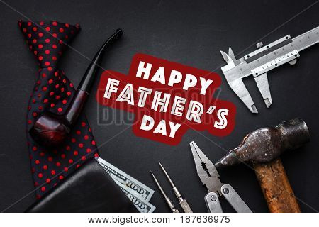 Happy Father's Day Text Sign With Tobacco Pipe And Tie Wallet Money And Many Tools On Black Rustic B
