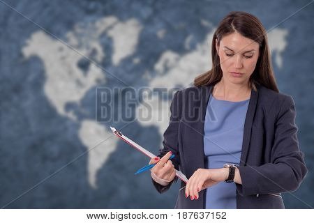 Business Woman Looking At Watch. World Map Globalization Concept.