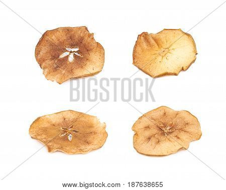 Dried slice of apple chips coated with cinnamon, isolated over the white background, set of four different foreshortenings